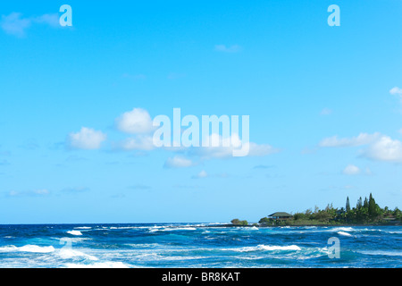 Water's Edge and Blue Sky - Stock Photo