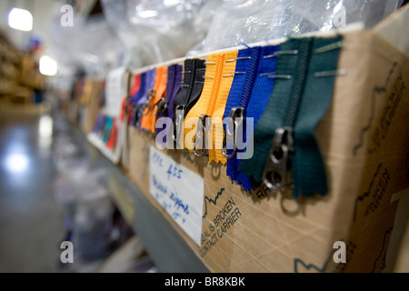 Zippers hanging out of a box in a clothing distribution center in Reno Nevada. - Stock Photo