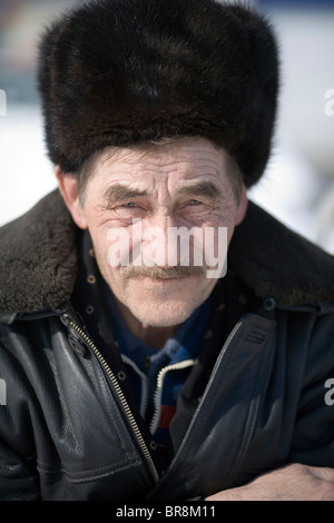 A portrait of a local man in the town center during the winter in Baikalsk Siberia Russia. - Stock Photo