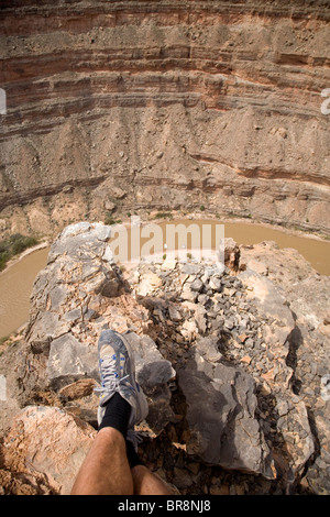A view down onto the San Juan river and a couple of boats Utah. - Stock Photo