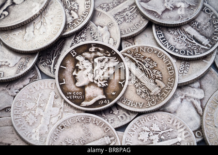 A pile of USA 90% silver metal content old dimes. Good for collectible or bullion themes. - Stock Photo