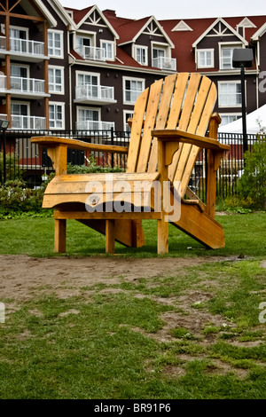 oversized Muskoka wooden chair cottage - Stock Photo
