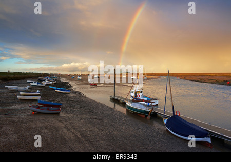 A rainbow over Wells next the Sea harbour on the North Norfolk Coast - Stock Photo