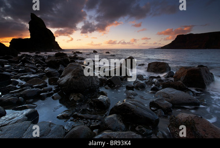 Sunset at Talisker Bay on the Isle of Skye - Stock Photo