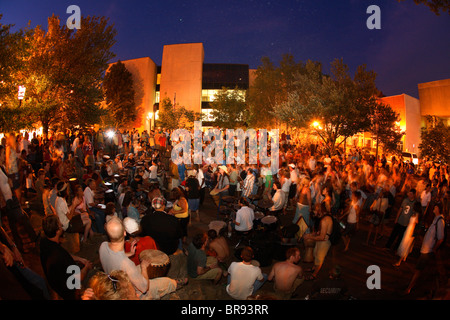 The weekly (Friday nights) drum circle in Pritchard Park in downtown Asheville NC - Stock Photo