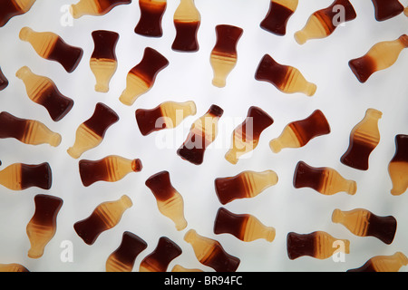cola bottle sweets on white back ground - Stock Photo