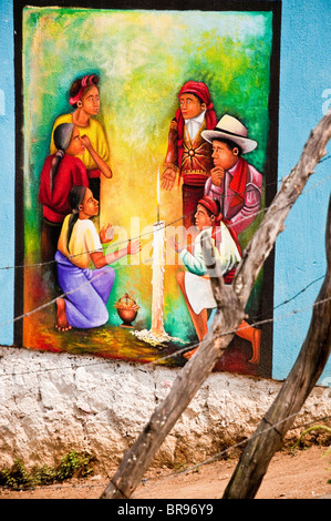 Traditional iconography on a painted wall representing the 'Mayan Ceremony' in San Juan La Laguna, Solola Guatemala - Stock Photo