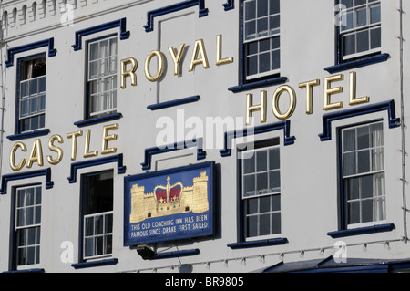 Front of historic Royal Castle Hotel on the Quay at Dartmouth in Devon with the sun on its white walls and blue - Stock Photo