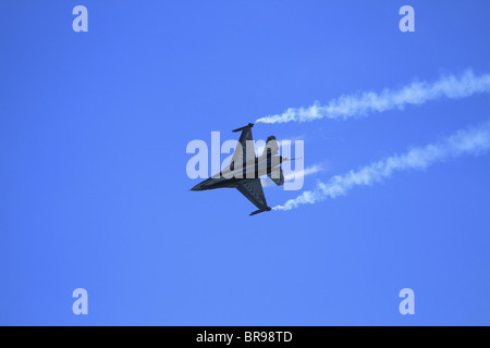 A Belgian Air Force F16 (Lockheed Martin F-16 Fighting Falcon) Fighter Jet performs at Eastbourne Air Show, East - Stock Photo