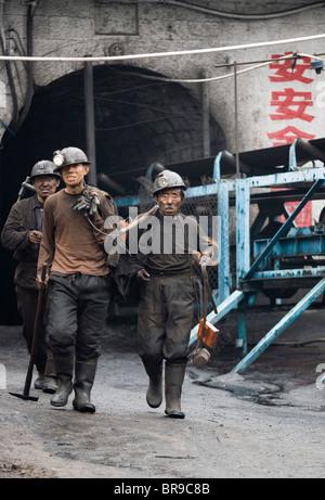 Coal miners in Shanxi China. - Stock Photo