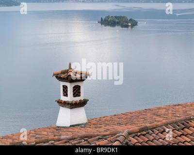 roof tiles - view from villa to maggiore lake and brissago island - canton of ticino - switzerland - Stock Photo