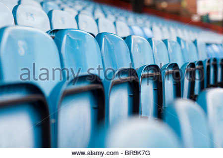 Empty seats in football stadium - Stock Photo