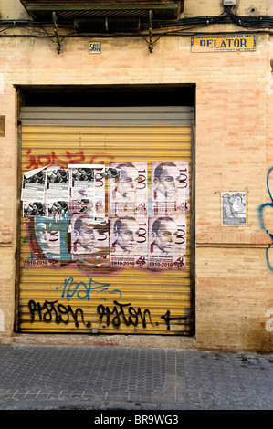 Graffiti and posters seen on a building in the Macarena area of Seville Spain - Stock Photo