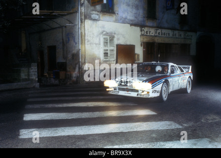 Walter Rohrl driving his Martini Lancia 037 on a stage through a village on the1983 Monte Carlo Rally - Stock Photo