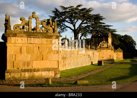 Evening sunlight casts a golden glow on the Magnesian limestone of the outer walls of Hardwick Hall in Derbyshire Stock Photo