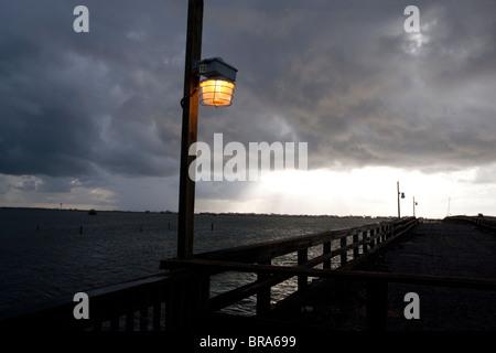 A dramatic  sunset  over the fishing pier at Grand Isle, Louisiana. - Stock Photo