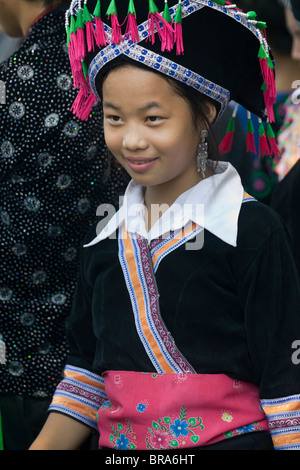 Lao P.D.R., Laos, Luang Prabang, young girl wearing traditional dress in a parade during the water throwing festival - Stock Photo