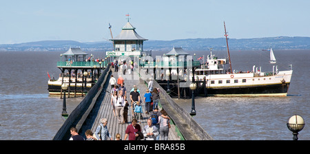 Passengers disembarking from the MV Balmoral docked at the end of the pier at Clevedon in Somerset on the Severn - Stock Photo