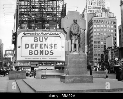 1940s BUY DEFENSE BONDS BILLBOARD AT STATUE OF FATHER DUFFY OF THE FIGHTING 69th OF WORLD WAR I AT TIMES SQUARE - Stock Photo