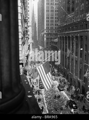 1940s 1945 AERIAL VIEW OF VE DAY CELEBRATION ON WALL STREET NYC WITH FLAGS AND CONFETTI FLYING - Stock Photo