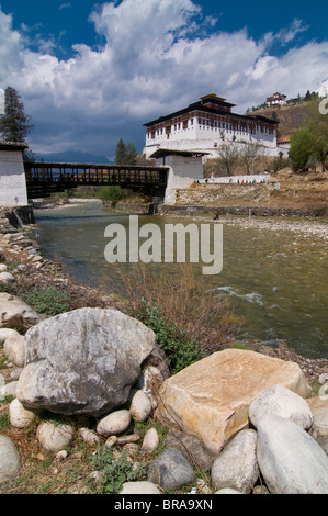 The Paro Tsong (a old castle) and a wooden covered bridge, Paro, Bhutan, Asia - Stock Photo