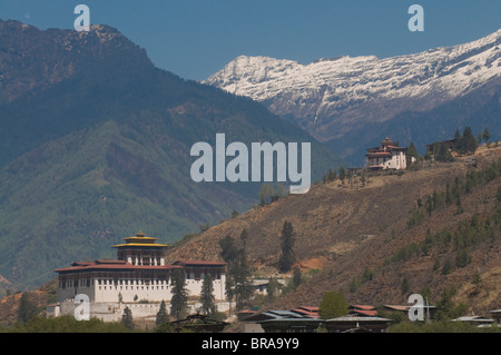 The Paro Tsong, old castle, with the Himalaya mountains in the background, Bhutan, Asia - Stock Photo