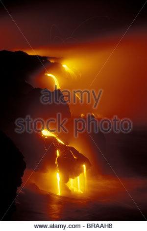 Lava flows off Lae'apuki Bench into sea during continuing eruption from Pu'u O'o, Kilauea Volcano, Hawaii Volanoes - Stock Photo