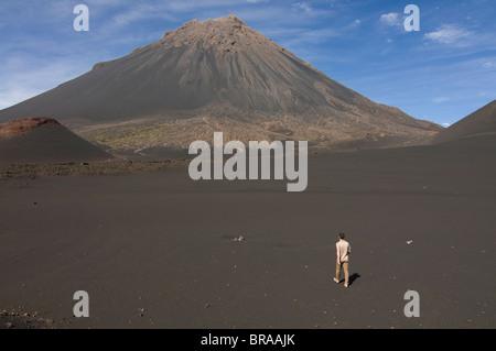 Man walking towards volcano on Fogo, Cape Verde Islands, Africa - Stock Photo