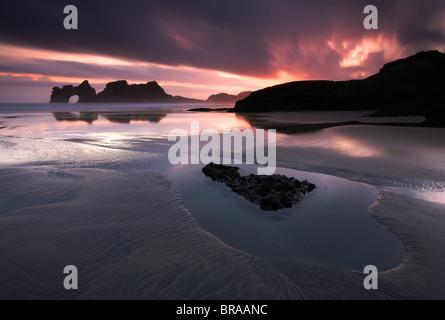 Sunrise on Wharariki Beach, Golden Bay, South Island, New Zealand - Stock Photo