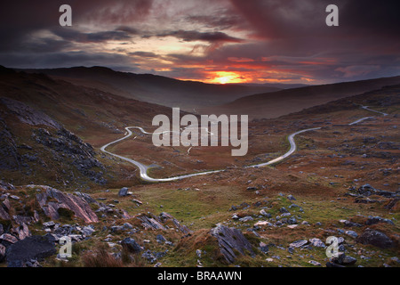 The road over the Healy Pass at dawn, Caha Mountains, Beara Peninsula, Co Cork, Ireland, October 2008 - Stock Photo
