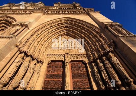 Portal of St-Anne of Notre Dame cathedral. city of Paris. Paris. France - Stock Photo