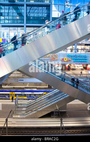 People moving up escalator at new modern main railway station, Berlin, Germany, Europe - Stock Photo