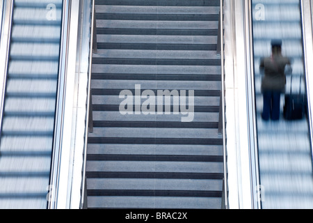 Escalator and stairs leading to the platform at modern train station, Berlin, Germany, Europe - Stock Photo