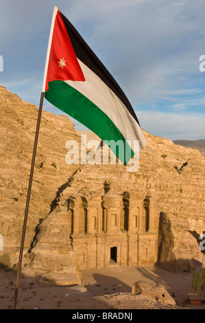 The Jordanian flag in front of Al Deir (the Monastery) at sunset, Petra, UNESCO World Heritage Site, Jordan, Middle - Stock Photo