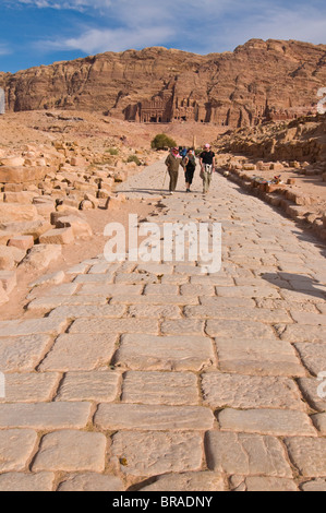 Old Roman cobbled street with view of the royal tombs, Petra, UNESCO World Heritage Site, Jordan, Middle East - Stock Photo