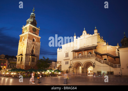 Town Hall Tower and Cloth Hall (Sukiennice) in Main Market Square (Rynek Glowny), UNESCO World Heritage Site, Krakow, - Stock Photo