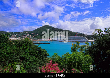 St Thomas in capital of Charlotte Amalie view from mountain showing ocean bay and Carnival Cruise Liberty at port - Stock Photo
