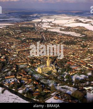 Aerial image of Salisbury Cathedral and city in snow, Salisbury, Wiltshire, England, United Kingdom, Europe - Stock Photo