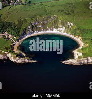 Aerial image of Lulworth Cove, a natural landform harbour, near West Lulworth, on the Jurassic Coast, UNESCO, Dorset, - Stock Photo