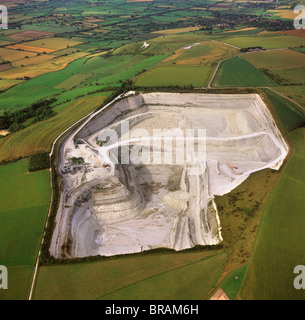 Aerial image of Westbury chalk quarry, with Westbury White Horse and Bratton Camp Hill Fort in background, Wiltshire, - Stock Photo