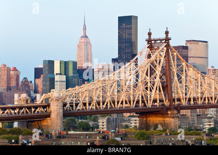 Queensboro Bridge, Manhattan skyline and the Empire State Building viewed from Queens at dawn, New York, USA - Stock Photo