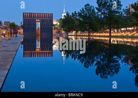 Reflecting Pool and The Gates of Time at the Oklahoma City National Memorial, Oklahoma City, Oklahoma, United States - Stock Photo
