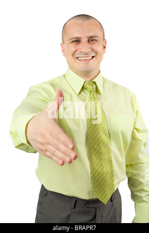 Friendly businessman offering handshake, isolated on white - Stock Photo