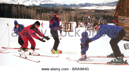 TOM CRUISE AND NICOLE KIDMAN teaching their new baby to ski Colorado USA - Stock Photo