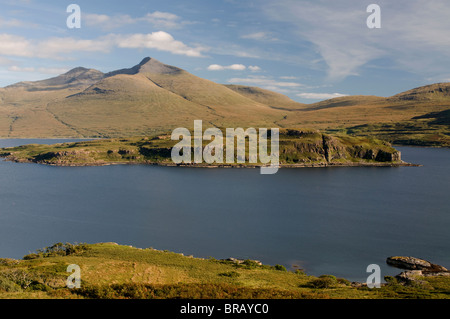 The uninhabited Island of Eorsa in Loch na Keal Mull with Ben More 967m towering beyond. Scotland.  SCO 6693 - Stock Photo