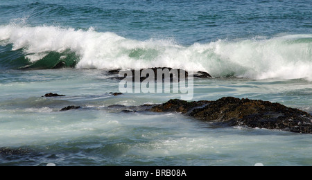 Waves breaking over rocks on the Atlantic Ocean off the west coast of South Africa - Stock Photo
