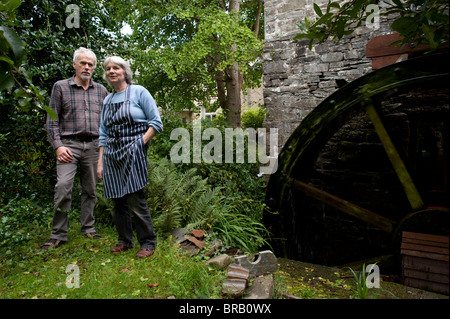 Andrew and Anne Parry at Felin Ganol Watermill. Llanrhystud, Ceredigiopn., Wales UK - restored 19th century water - Stock Photo