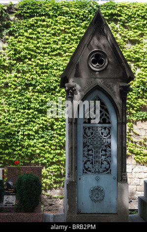 Tomb, Montparnasse Cemetery, Paris, France - Stock Photo