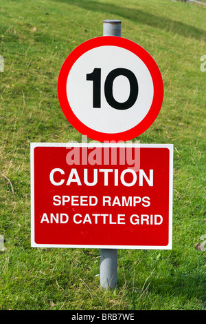 10 mph speed limit sign warning of ramps and cattle grid, West Yorkshire, England, UK - Stock Photo