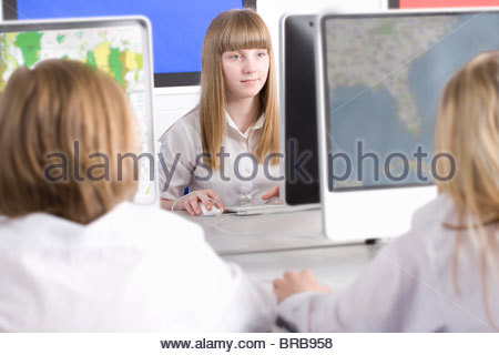 Students working on computers in school computer lab - Stock Photo